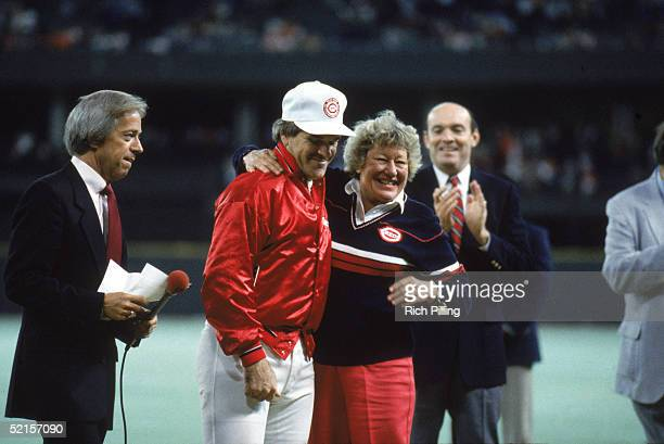 Pete Rose of the Cincinnati Reds stands with the owner Marge Schott of the Reds during the victory on scoring his 4192 hit off of pitcher Eric Show...