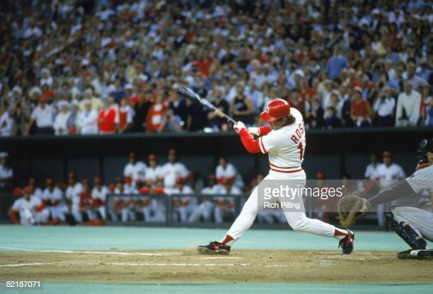 Pete Rose of the Cincinnati Reds swings at a pitch against the San Diego Padres during a game on September 11 1985 at Riverfront Stadium in...