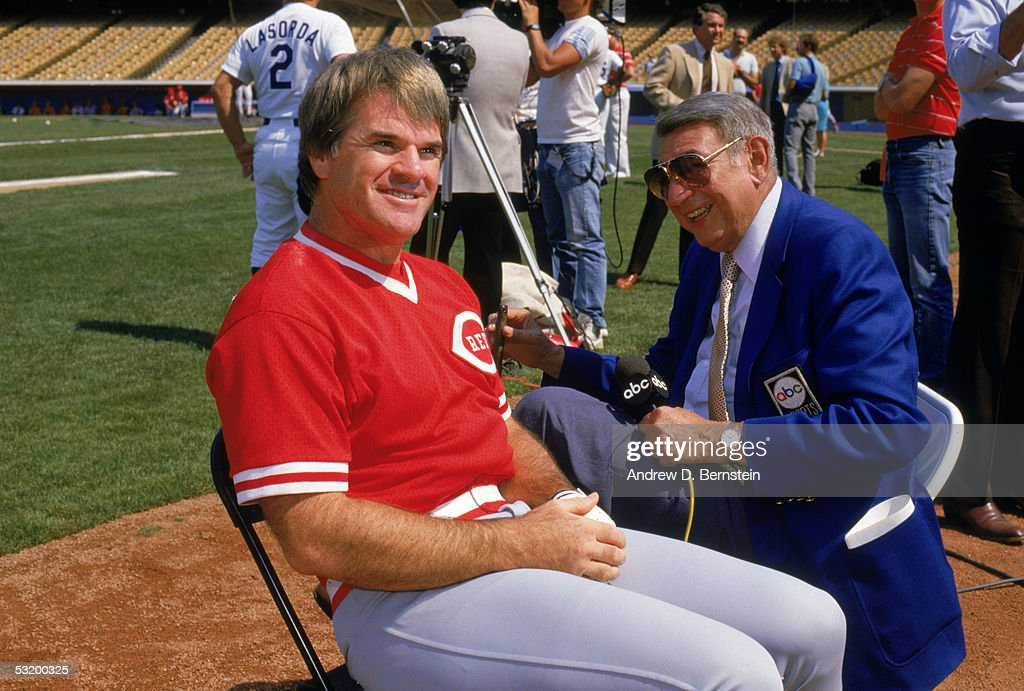 Pete Rose #14 of the Cincinnati Reds talks with ABC's sports commentator Howard Cosell prior to a game against the Los Angeles Dodgers at Dodger Stadium in Los Angeles, California. Pete Rose played for the Reds from 1963-1978 and from 1984-1986.