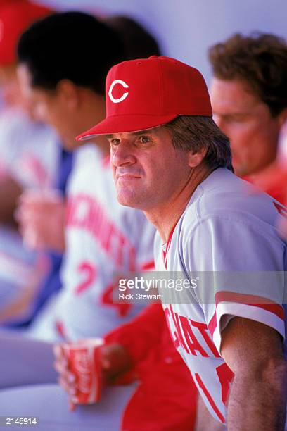 Pete Rose of the Cincinnati Reds watches from the dugout during a MLB game in the 1985 season
