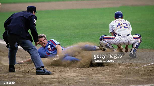 Pete Rose of the Montreal Expos scores as Ron Hodges of the New York Mets goes for the ball at Shea Stadium on June 24 l984 in Flushing New York The...