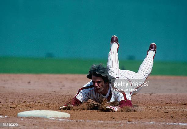 Pete Rose of the Philadelphia Phillies dives head first into third base during spring training on 1979 in Clearwater, Florida.