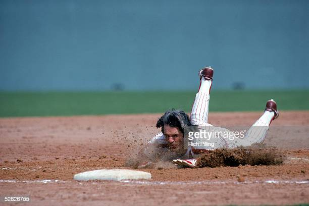 Pete Rose of the Philadelphia Phillies dives head first into third base during a season game at Veterans Staddium in Philadephia Pennsylvania Pete...