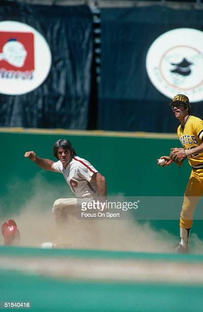 Pete Rose of the Philadelphia Phillies leaves a cloud of dust after sliding into second base at Veterans Stadium during the early 1980s in...