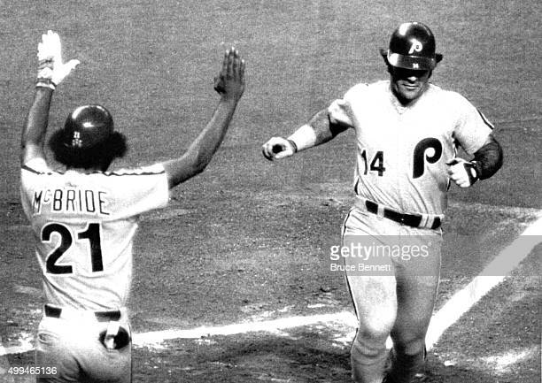 Pete Rose of the Philadelphia Phillies scores a run as he is congratulated by Bake McBride during an MLB game against the Houston Astros on August 17...