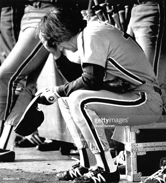 Pete Rose of the Philadelphia Phillies sits dejected in the dugout after the Phillies lost to the Montreal Expos in Game 2 of the 1981 National...
