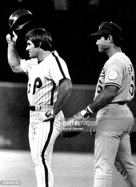 Pete Rose of the Philadelphia Phillies tips his helmet to the crowd after getting a base hit to place him fourth place on the all-time hit list with...