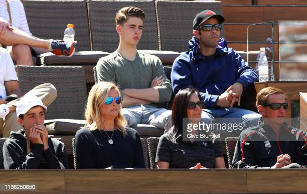 Pete Sampras his wife Bridgette Wilson and their two sons watch Dominic Thiem of Austria play against Milos Raonic of Canada during their men's...