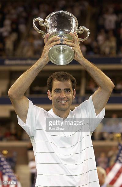 Pete Sampras lifts his trophy during the US Open September 8 2002 at the USTA National Tennis Center in Flushing Meadows Corona Park in Flushing New...