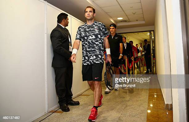 Pete Sampras of the Indian Aces walks from the locker room with team mate Roger Federer as they make their debut for the Indian Aces against the...