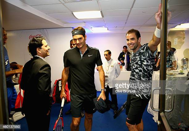 Pete Sampras of the Indian Aces with team mate Roger Federer as they make their debut for the Indian Aces against the Singapore Slammers during the...