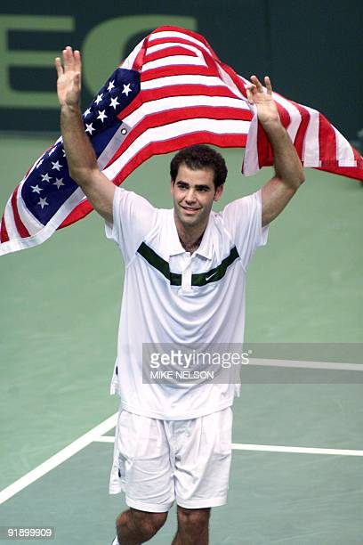 Pete Sampras of the United States holds the US flag after his victory Slava Dosedel of the Czech Republic during the Davis Cup quarterfinals in Los...