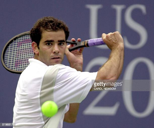 Pete Sampras of the US lines up a backhand return to Lleyton Hewitt of Australia 09 September 2000 during their semifinal match of the US at the US...