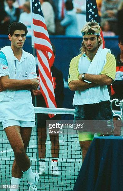 Pete Sampras of the USA and Andre Agassi of USA are seen after the final match at the US Open in Flushing Meadows on August 27 1990 in New York...