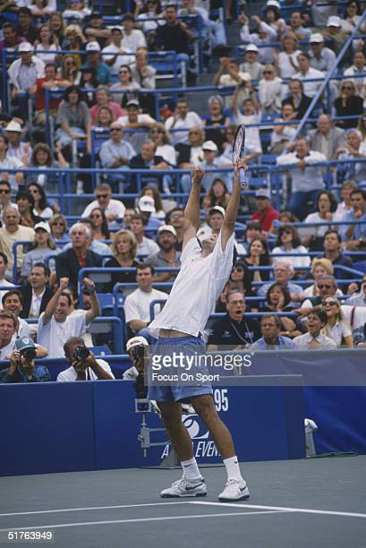 Pete Sampras raises his hands up in victory after defeating Andre Agassi at the US Open on September 10 1995 in Flushing New York