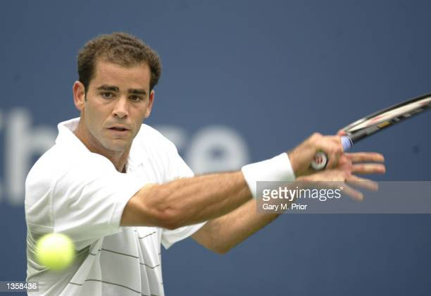 Pete Sampras returns a shot to Albert Portas of Spain during the US Open on August 28 2002 at the USTA National Tennis Center in Flushing Meadows...