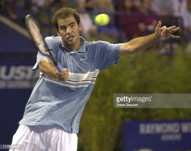 Pete Sampras returns a shot to Michael Chang in the second round