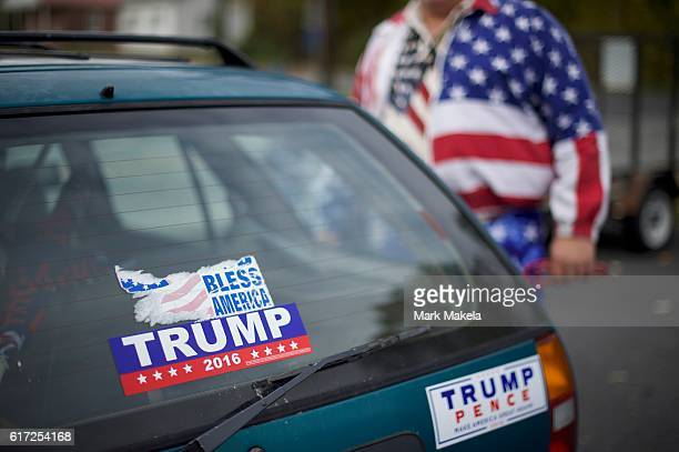 Pete Seville's car features Donald Trump campaign bumper stickers near a near the venue where the Republican Presidential nominee holds an event at...