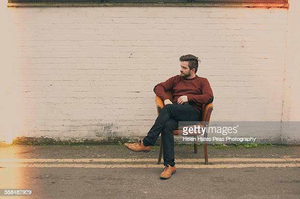 Pete Smyth sitting on a chair outside