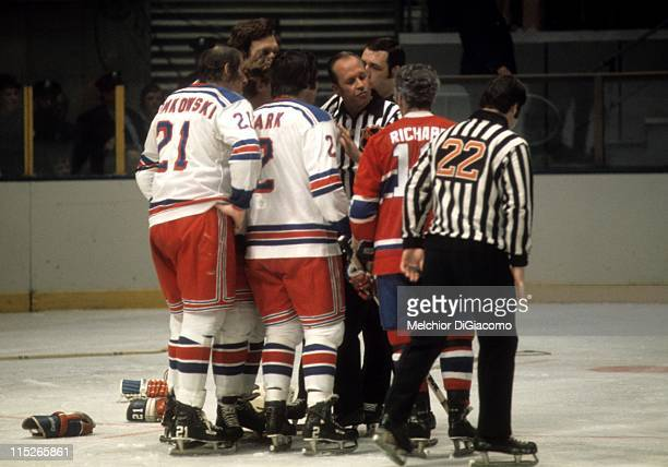 Pete Stemkowski Brad Park of the New York Rangers and Henri Richard of the Montreal Canadiens talk with the referee after a fight between the two...