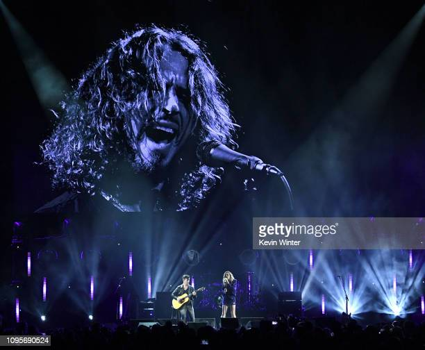 Pete Thom and Miley Cyrus performs at I Am The Highway A Tribute to Chris Cornell at the Forum on January 16 2019 in Inglewood California