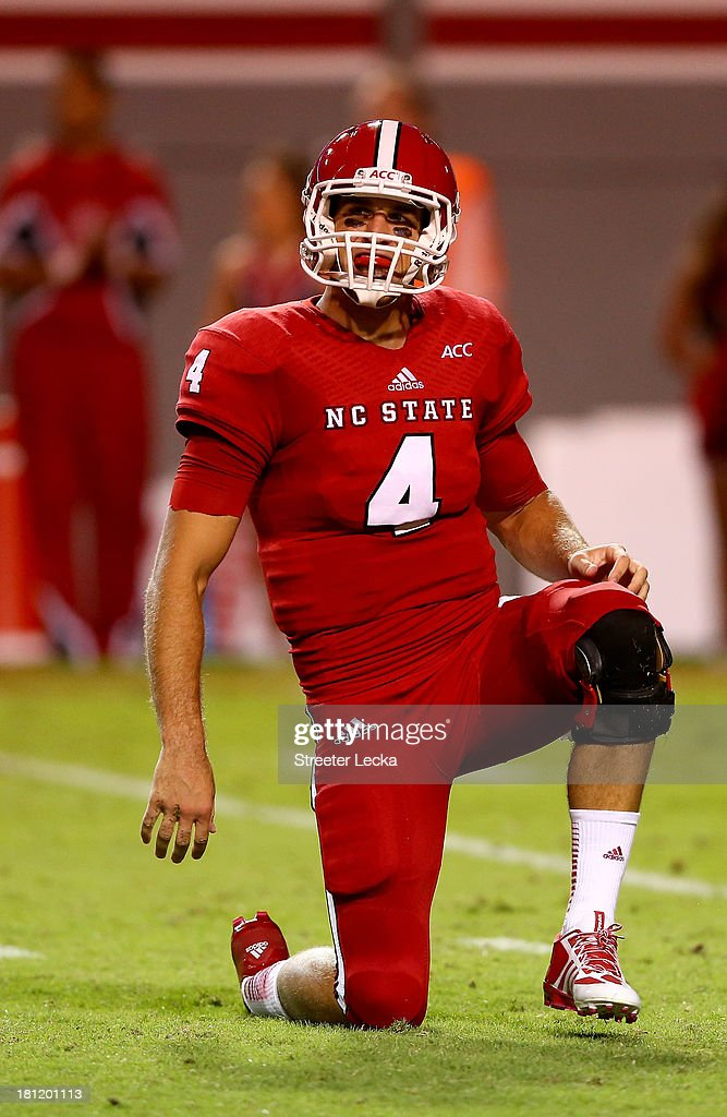 Pete Thomas #4 of the North Carolina State Wolfpack gets off the ground after a hit against the Clemson Tigers during their game at Carter-Finley Stadium on September 19, 2013 in Raleigh, North Carolina.