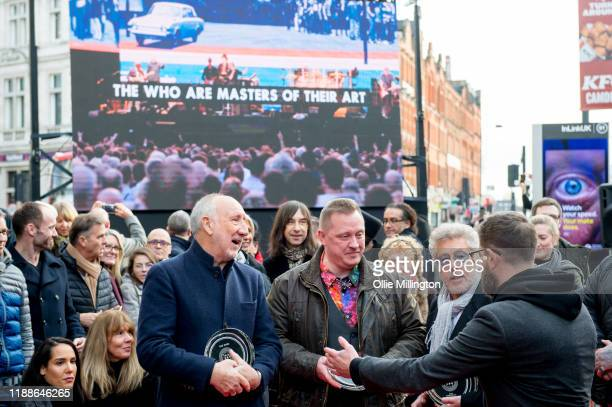 Pete Townshend and Roger Daltrey of The Who pose with Christopher Entwistle at the Music Walk Of Fame for their Founding Stone Unveiling on Camden...