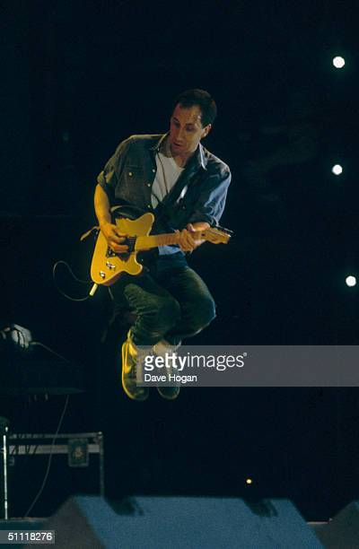 Pete Townshend British guitarist with The Who leaps into the air during a performance at the Live Aid charity concert Wembley 13th July 1985