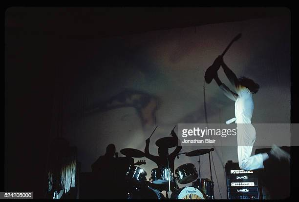 Pete Townshend jumps high on the stage while The Who performs at Tanglewood Summer Contemporary Trends concert in Lenox Massachusetts