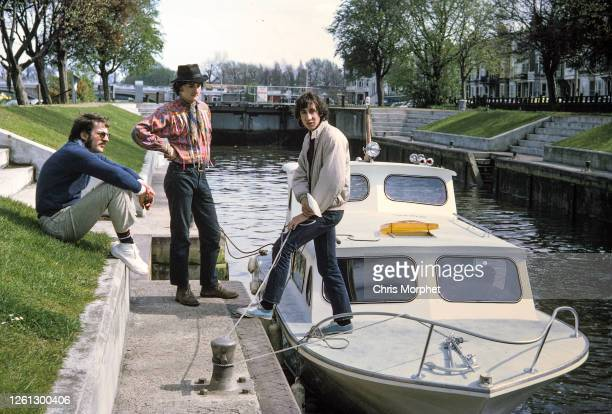 Pete Townshend of The Who , director Richard Stanley , with Who road manager Dave 'Cyrano' Langston between them, on a boat in a lock on River...