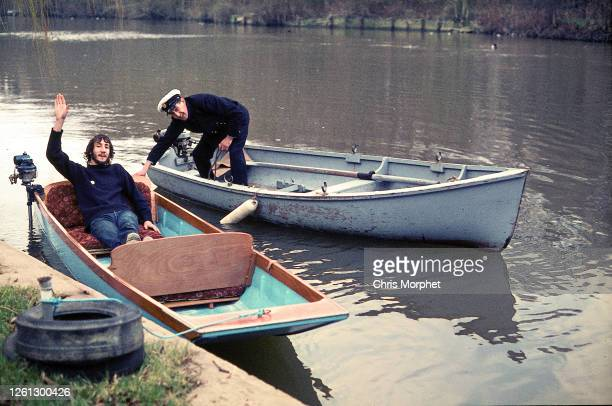 Pete Townshend of The Who in boat with Goring lock keeper, Goring, River Thames, United Kingdom, circa early 1970s.