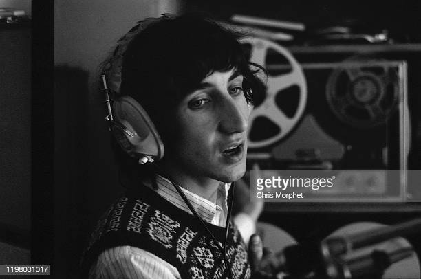 Pete Townshend of The Who in his home recording studio during the making of the film 'The Lone Ranger', Ebury Street, London, 1968. A Revox G36 tape...