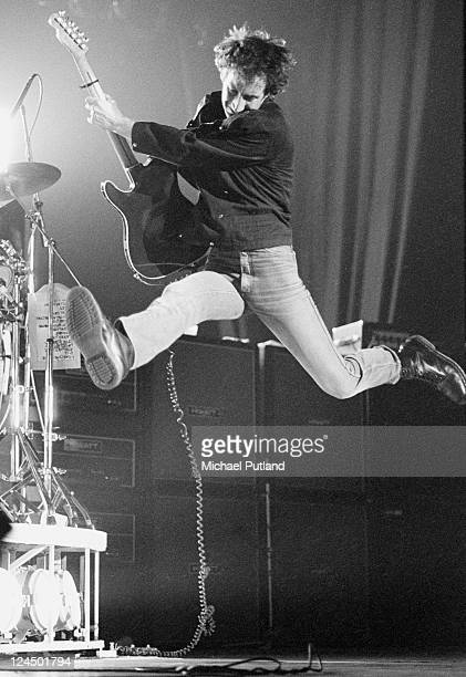 Pete Townshend of The Who leaps in the air while performing live on stage London February 1981