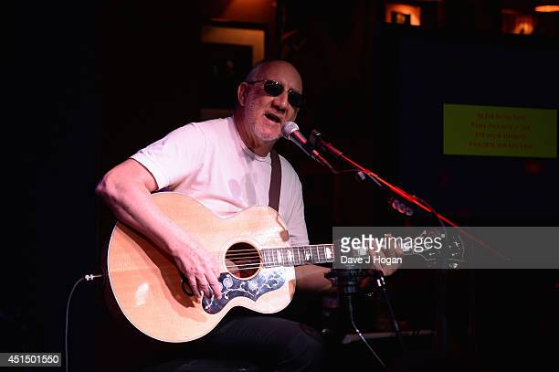 Pete Townshend of The Who performs onstage as he attends The 50th Anniversary Photocall of The Who at Ronnie Scott's on June 30 2014 in London England