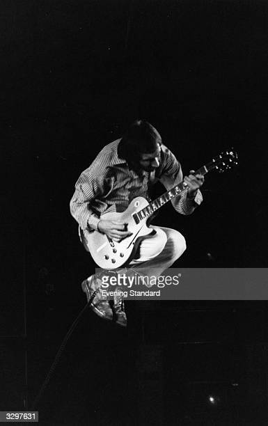 Pete Townshend songwriter and guitarist of the British rock band The Who seen in flight whilst playing with the band on stage in 1975