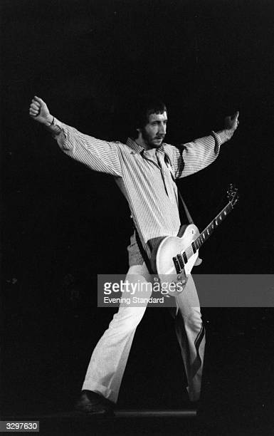Pete Townshend songwriter and guitarist with British rock group The Who, performing on stage.