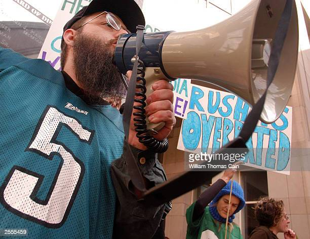 Pete Tridish wears a Donovan McNabb jersey as he protests Rush Limbaugh's appearance at the National Association of Broadcasters October 2 2003 in...