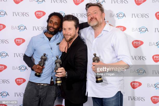 Pete Turner Mark Potter and Guy Garvey of Elbow with the award for Best Song Musically and Lyrically pose in the winner's room during the Ivor...