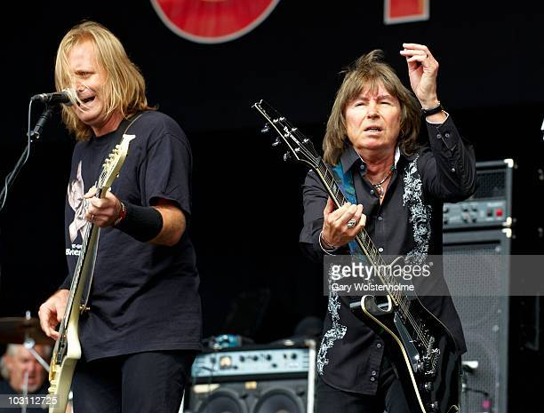 Pete Way and Paul Raymond of UFO performs on stage during day two of High Voltage Festival at Victoria Park on July 25 2010 in London England