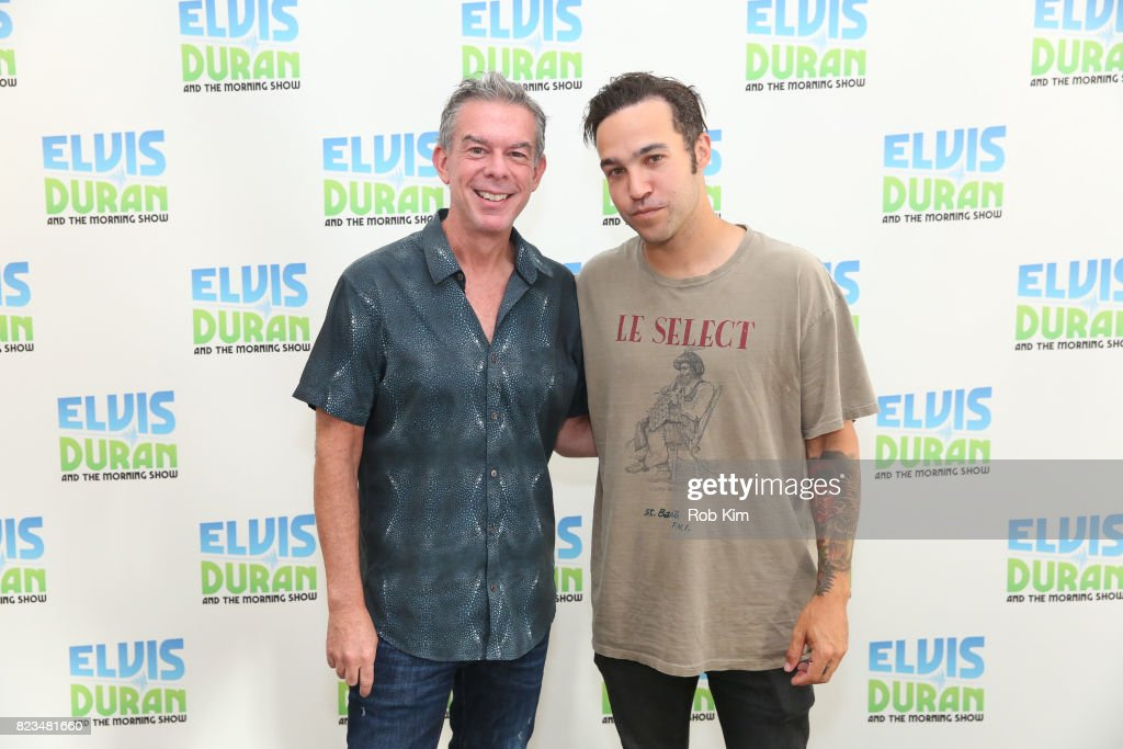 Pete Wentz and Elvis Duran pose for a photo at