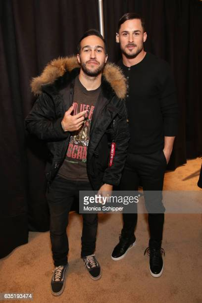 Pete Wentz and guest pose backstage for the Philipp Plein collection during New York Fashion Week The Shows at New York Public Library on February 13...
