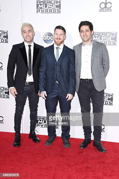 Pete Wentz Andy Hurley and Joe Trohman of Fall Out Boy winners of the Favorite Alternative Artist award attend the 2015 American Music Awards at...