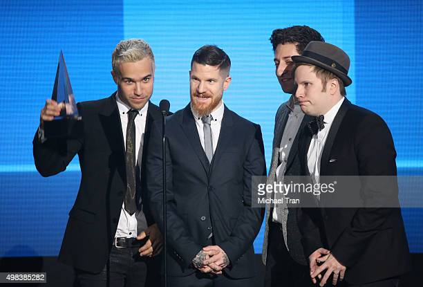 Pete Wentz Andy Hurley Joe Trohman and Patrick Stump of Fall Out Boy speak onstage at the 2015 American Music Awards at Microsoft Theater on November...