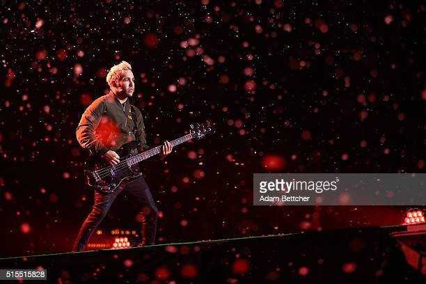 Pete Wentz from the band Fall Out Boy performs while fake snow falls at Xcel Energy Center on March 13, 2016 in St. Paul, Minnesota.
