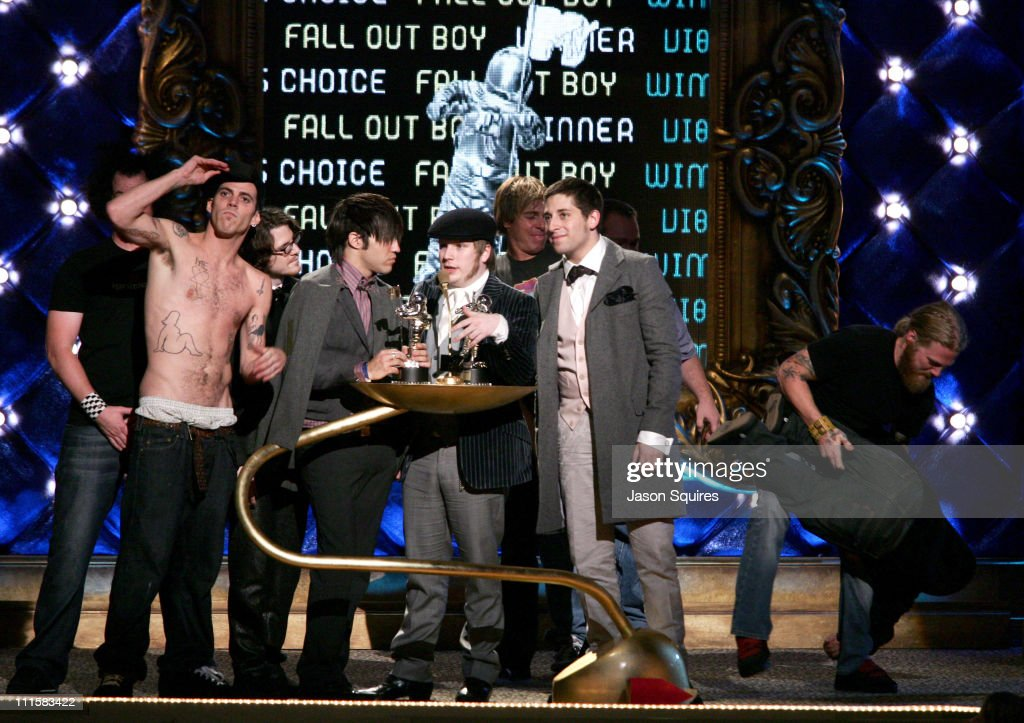 Pete Wentz, Patrick Stump and Joe Trohman of Fall Out Boy, winners of Viewer's Choice Award for 'Dance, Dance', accept from Steve-O, Chris Pontius, Bam Margera and the cast of 'Jackass'