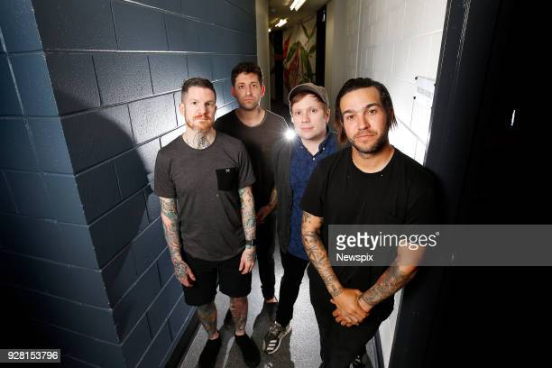 BRISBANE QLD Pete Wentz Patrick Stump Joe Trohman and Andy Hurley of Fall Out Boy pose backstage at the Riverstage in Brisbane Queensland