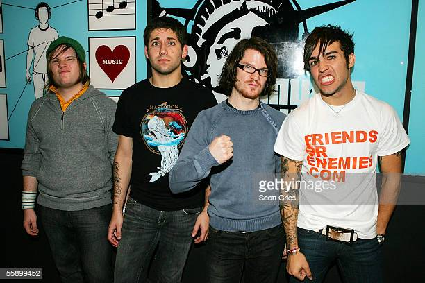 Pete Wentz Patrick Stump Joseph Trohman and Andrew Hurley of Fall Out Boy pose for a photo backstage during MTV's Total Request Live at the MTV Times...