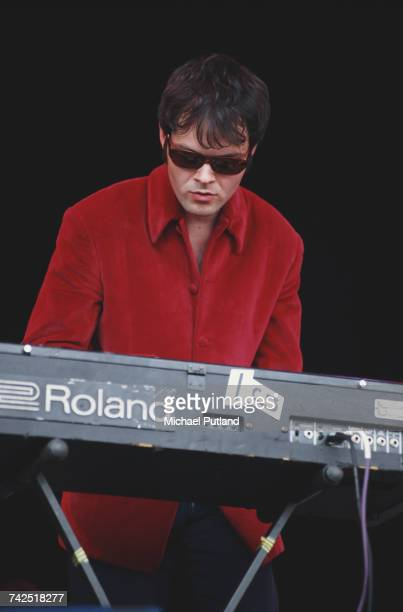 Pete Wiggs of English band Saint Etienne performs live on stage playing a Roland keyboard on the Pyramid Stage at the 1994 Glastonbury Festival near...