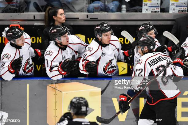 Peter Abbandonato of the Rouyn-Noranda Huskies celebrates his second period goal with teammates on the bench against the Blainville-Boisbriand Armada...