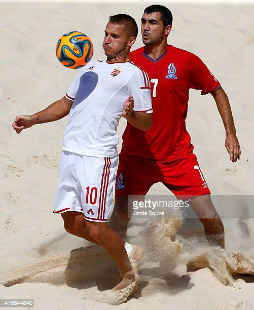 Peter Abel of Hungary holds off Zeynal Zeynalov of Azerbaijan in the Men's Beach Soccer Classification match during day sixteen of the Baku 2015...